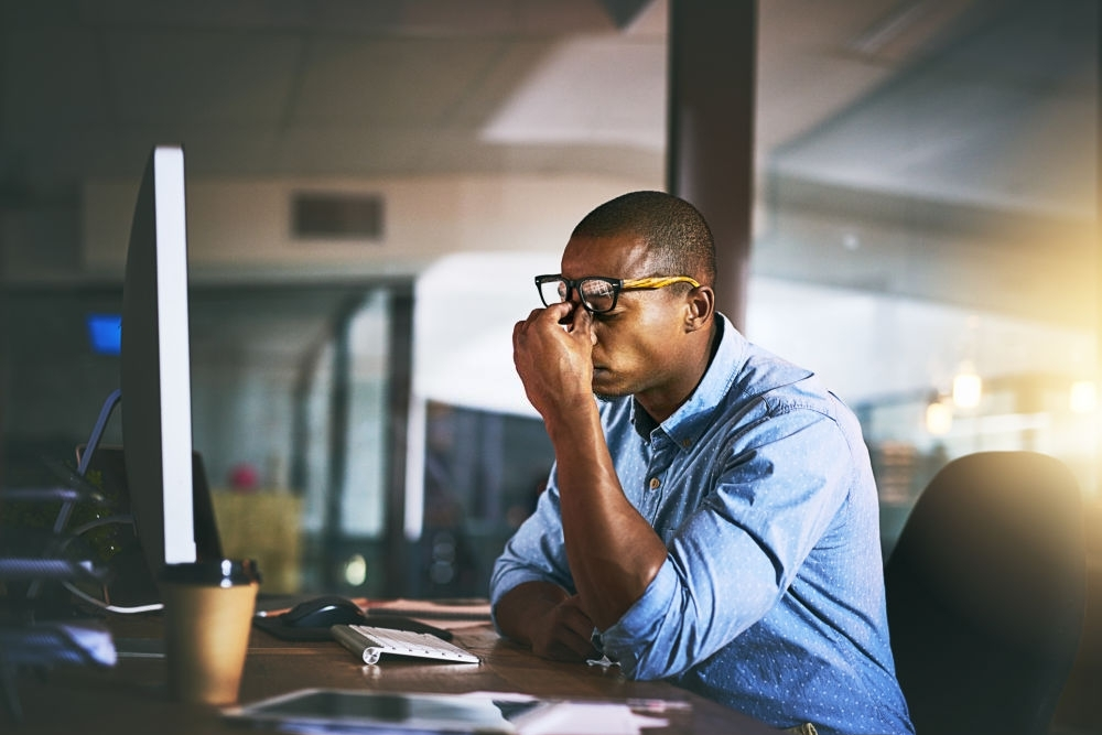 A man pondering on losses in business as a result of mistakes